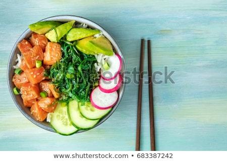 hawaiian poke bowl with salmon rice and vegetable stock photo © furmanphoto