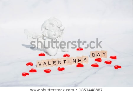 Valentine theme with cute cupid and red hearts Stock photo © bluering