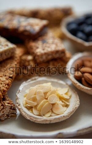 Close up of Almond petals. With various energy nutrition bars in background Stock photo © dash