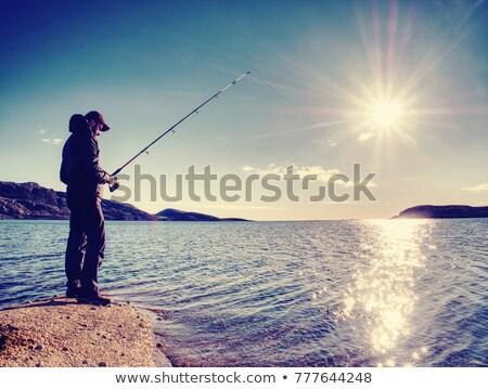 Man exploring the coast line at sunset Stock photo © iko