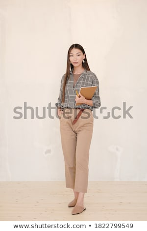 Portrait of a beautiful young businesswoman looking at the camer Stock photo © HASLOO