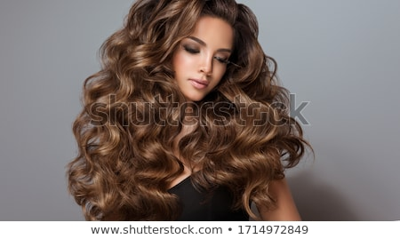 brown-haired woman looking at photos Stock photo © photography33
