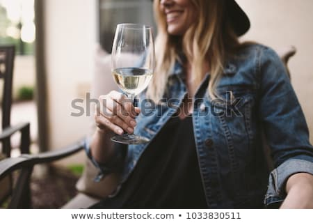 Blonde woman with a glass of white wine Stock photo © photography33