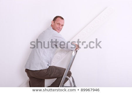 Decorator with rolls of wallpaper and pots of paint Stock photo © photography33