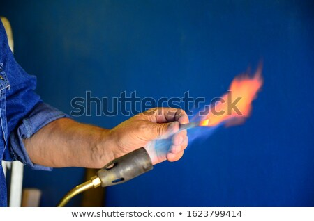 Man aiming a blowtorch Stock photo © photography33