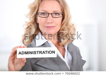 Blond office worker holding administrator  badge Stock photo © photography33
