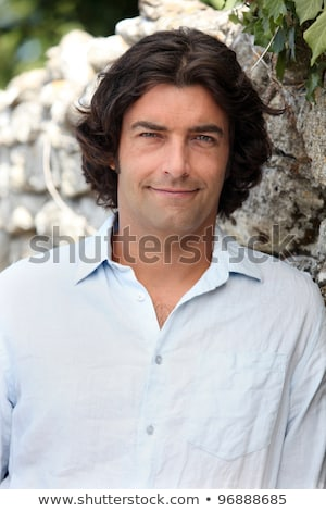 Man with longer length hair standing in front of a tree Stock photo © photography33