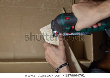 Man cutting a piece of wood with a jigsaw Stock photo © photography33
