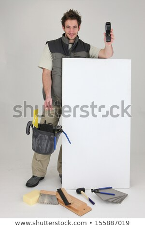 Man advertising his tiling services Stock photo © photography33