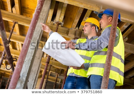 construction site supervisor looking at a blueprint Stock photo © photography33