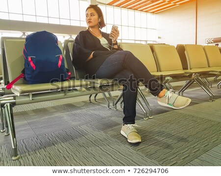 young woman listening to music on her laptop stock photo © photography33