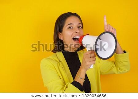 Positive businesswoman using a megaphone  Stock photo © wavebreak_media