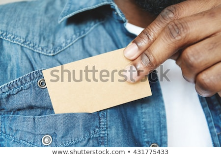 Executive pulling businesscard from pocket Stock photo © photography33
