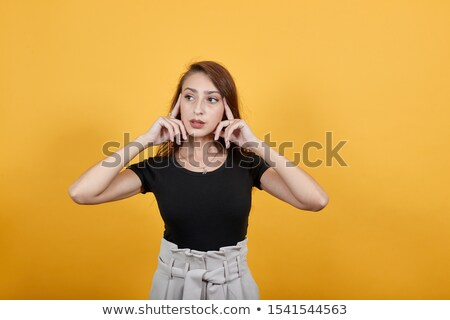 Young female pointing at something specific Stock photo © stockyimages