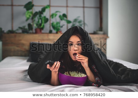 young attractive woman watching movie tv expression stock photo © juniart