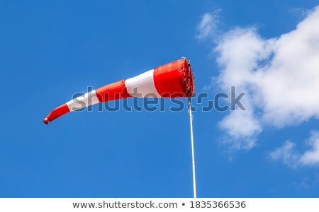 wind red and white sock against a blue sky Stock photo © fotoduki