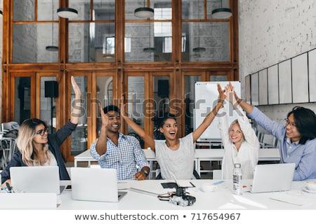 Animado grupo extático parceiros de negócios olhando Foto stock © pressmaster