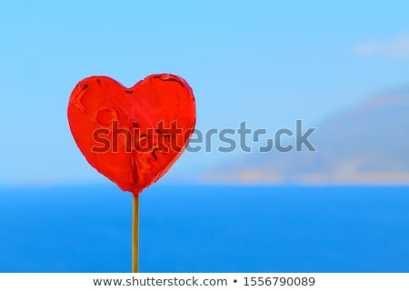 Stock photo: Colorful heart shaped lollipop on sky background