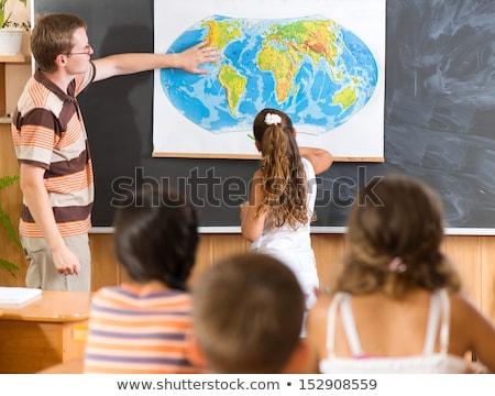 Fiatal iskolás lány földrajz osztály ül asztal Stock fotó © stryjek