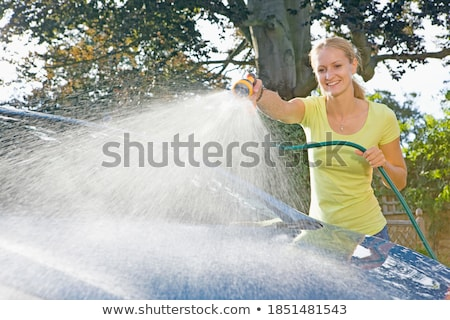 Hose Spraying Water On Windscreen Stock photo © AndreyPopov