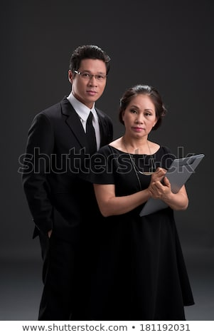 Serious Woman in a Dress Holding Ballpoint Pen Stock photo © juniart