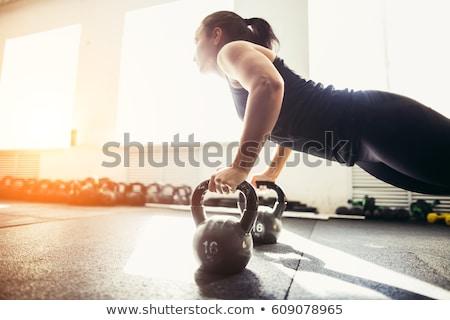 smiling bodybuilder lifting up kettlebell stock photo © wavebreak_media