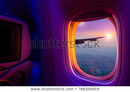 Sunset Sky Through Airplane Window Stock photo © sippakorn