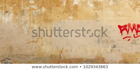 old cracked plaster fence stock photo © taigi
