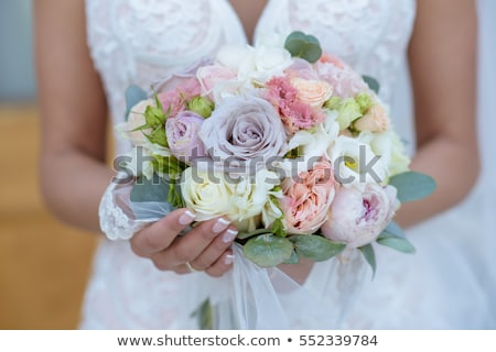 Beautiful bridal bouquet. Bride's and groom's hands close-up Stock photo © amok