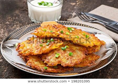 Aardappel pannenkoeken zwarte koekenpan groep olie Stockfoto © Mikko