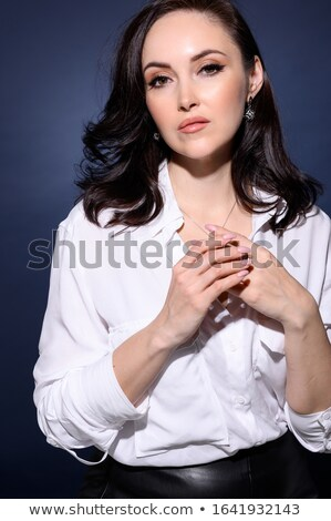 Elegant middle aged woman posing with woolen warm scarf Stock photo © dash