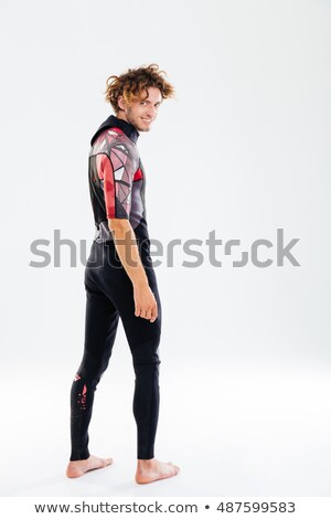 Smiling happy man in diving suit looking over his shoulder Stock photo © deandrobot