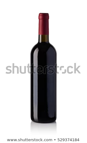 a bottle of red wine isolated on white stock photo © kayros