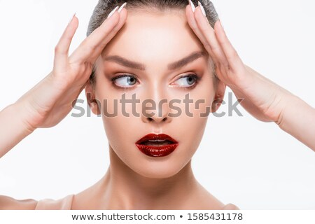 Attractive young model with red lips and forehead in shadow  Stock photo © julenochek