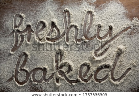The word freshly baked written on sprinkled flour Stock photo © wavebreak_media