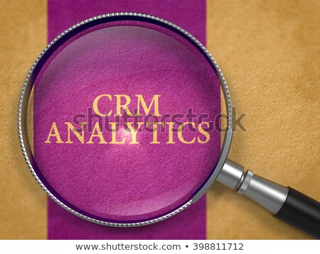 CRM Analytics through Magnifying Glass. Stock photo © tashatuvango