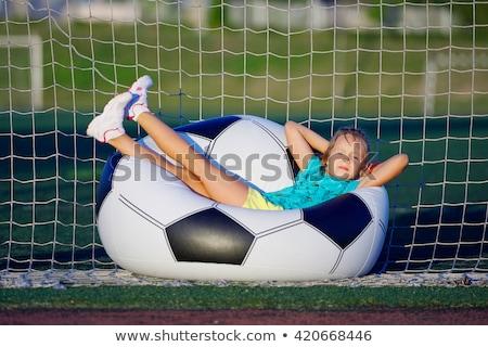 girl with big soccer ball stock photo © traimak