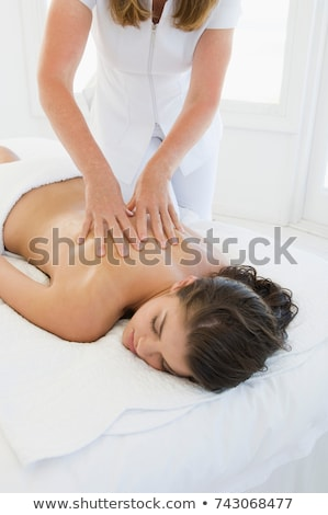 Female being given massage Stock photo © IS2