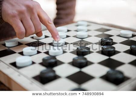 játszik · kanapé · játék · ül · stratégia · szabadidő - stock fotó © IS2
