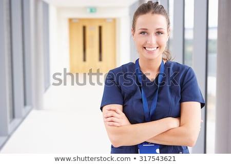 hemşire · ayakta · hastane · koridor · portre · pembe - stok fotoğraf © wavebreak_media