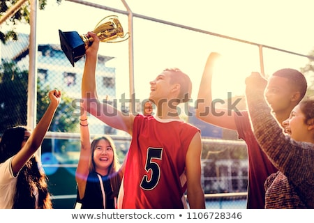 Boy holding up a basketball trophy Stock photo © IS2