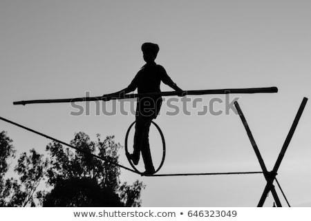 мальчика ходьбе туго натянутый канат иллюстрация человека спорт Сток-фото © bluering