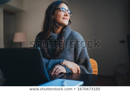 Successful female entrepreneur talking on mobile phone in a co-working space Stock photo © Kzenon