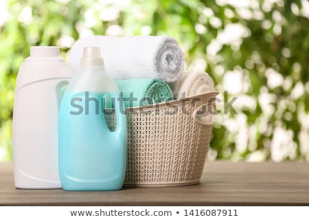 Terry towels and detergent in the laundry basket Stock photo © Epitavi