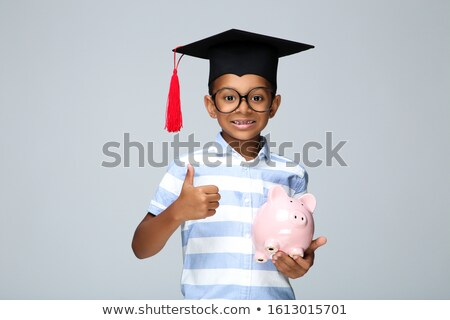 Person Holding Graduation Hat And Coins Stock photo © AndreyPopov