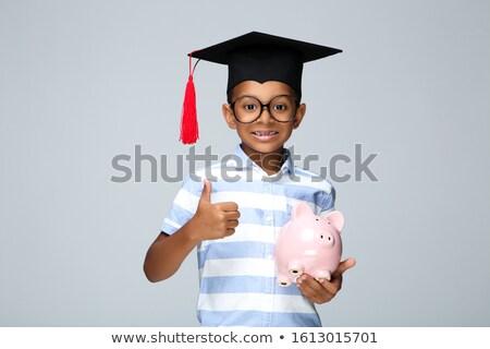 Pessoa graduação seis moedas Foto stock © AndreyPopov