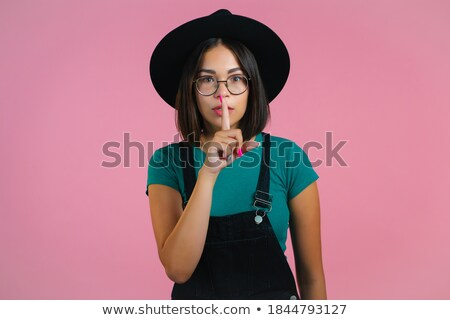 woman with pink lipstick holding finger on mouth Stock photo © dolgachov