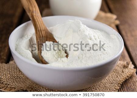 Geheel melk poeder kom vol room Stockfoto © Digifoodstock