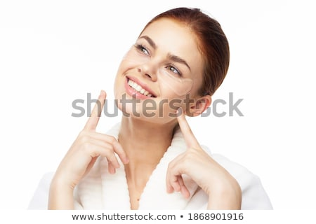 Young pretty woman with clean and fresh skin posing on golden bl Stock photo © Nobilior