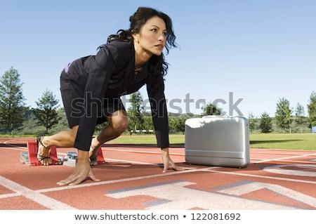 running sports. beautiful woman in starting position Stock photo © studiostoks